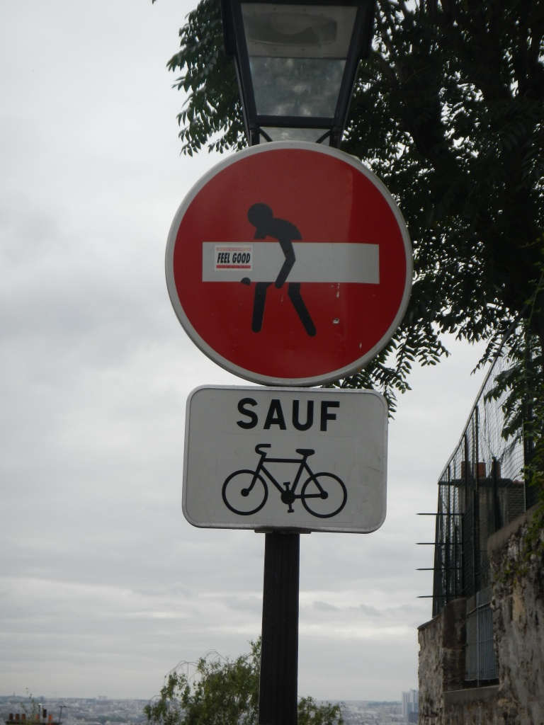 modified street sign showing a stick figure