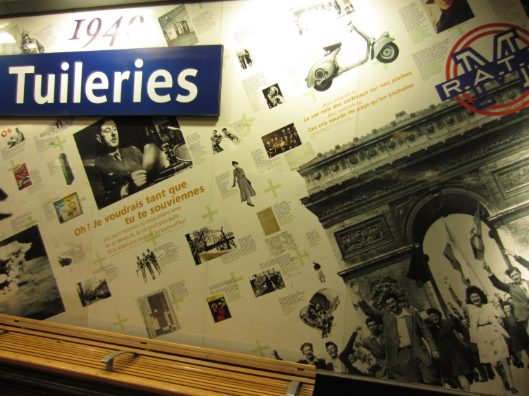 a paris metro with lots of pictures on the wall