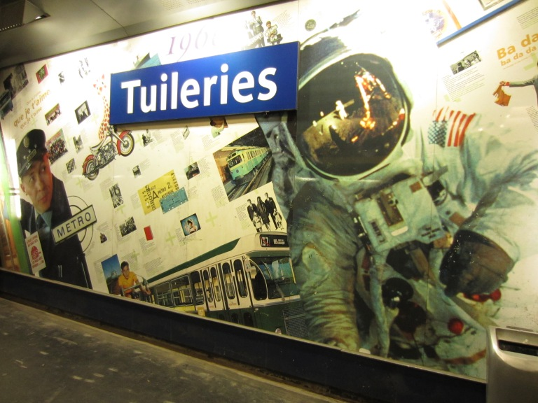 a paris metro station with a picture of an astronaut