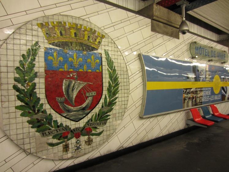 paris coat of arms on a paris metro wall