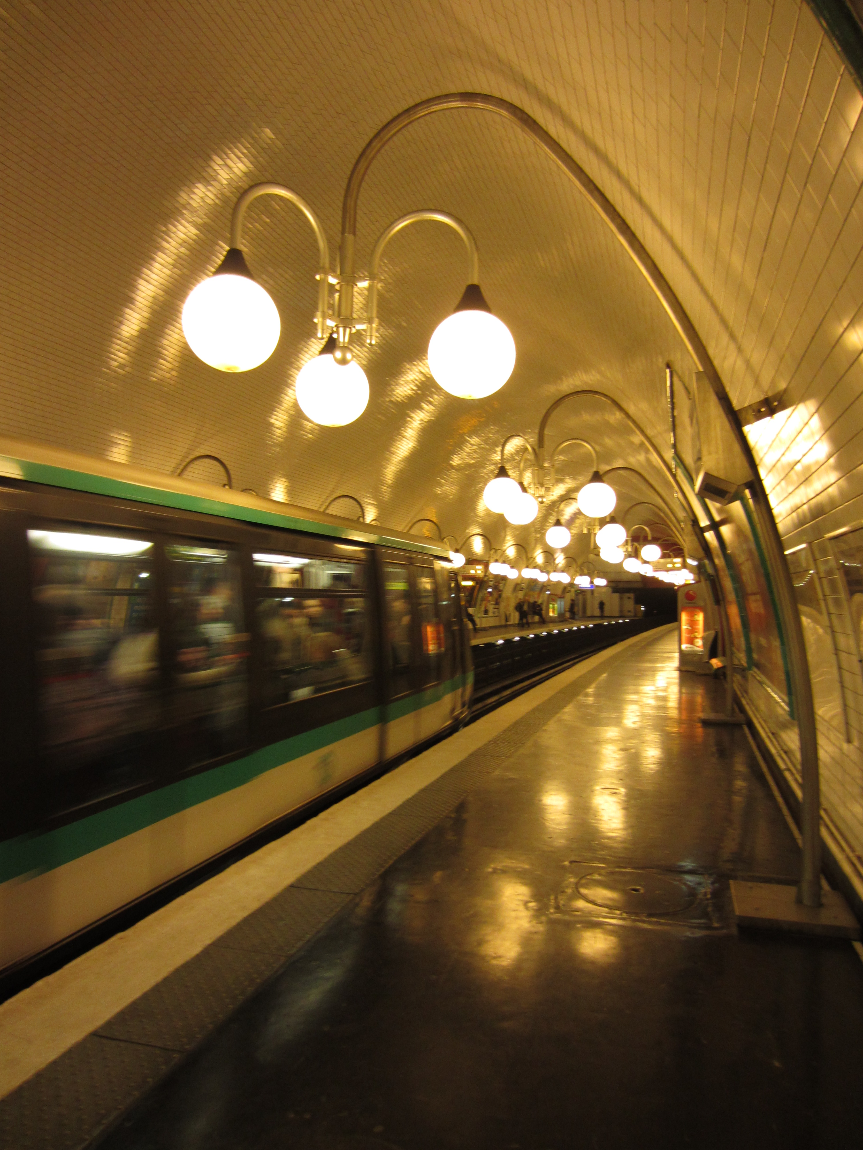 light globes in a paris metro station