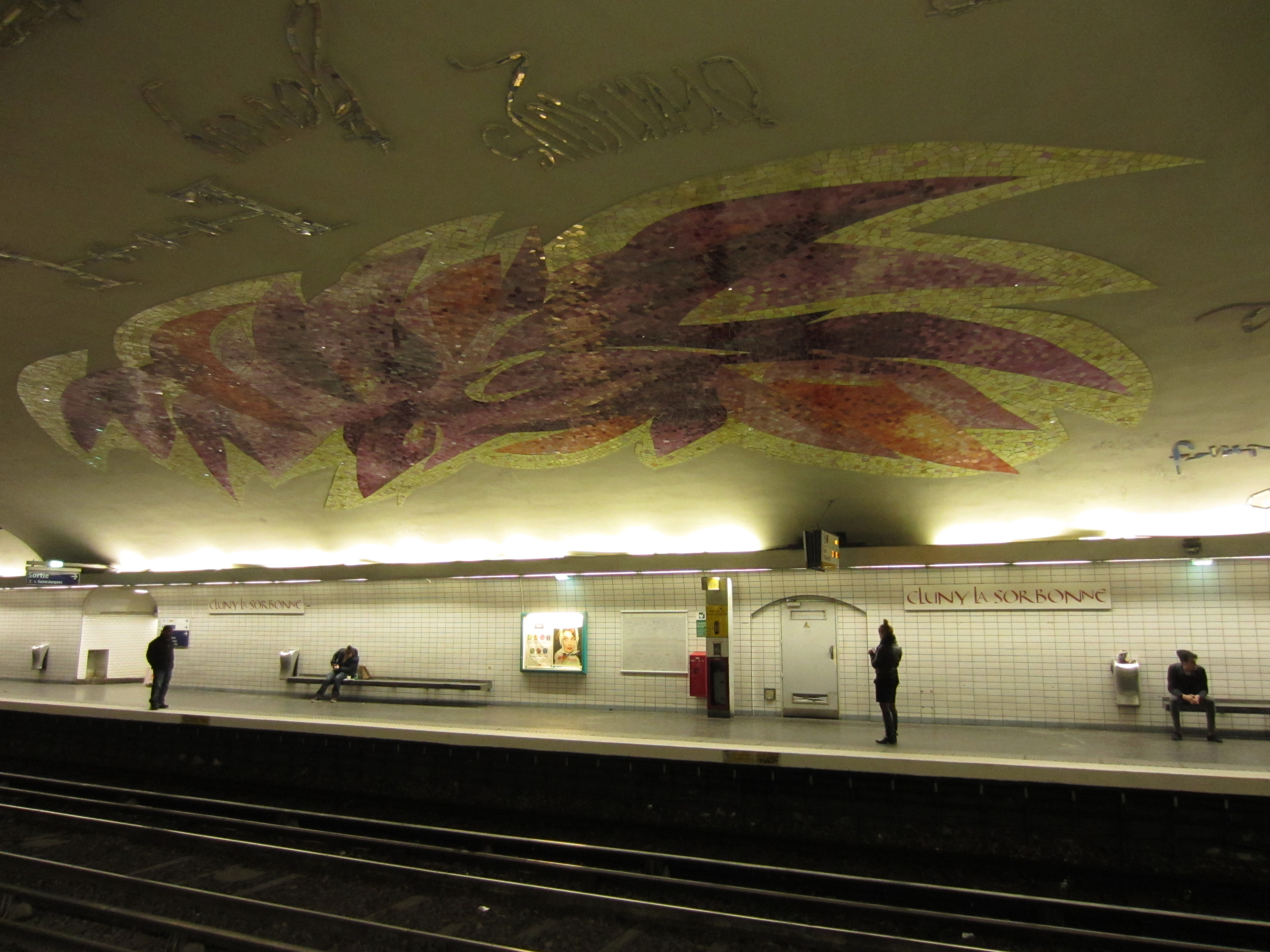 a mosaic design on the walls of a paris train station