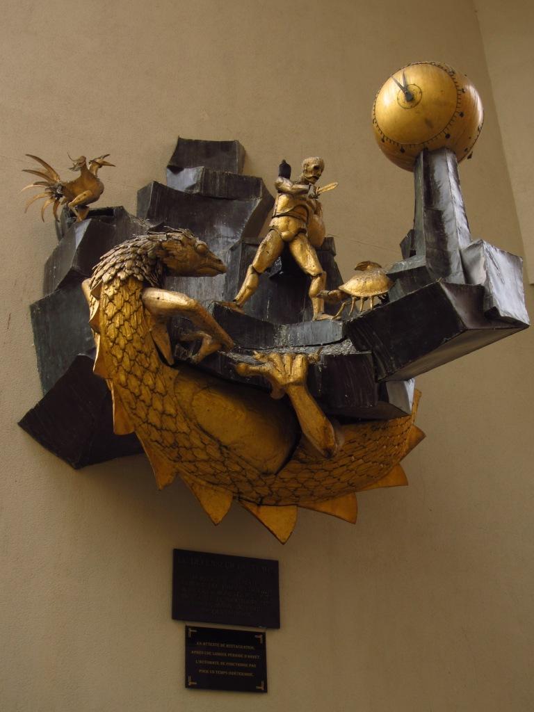 A mechanical sculpture in paris showing a warrior battling animals
