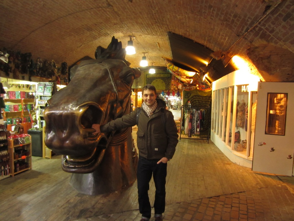 Derrick poses with a big horse head. Duh.