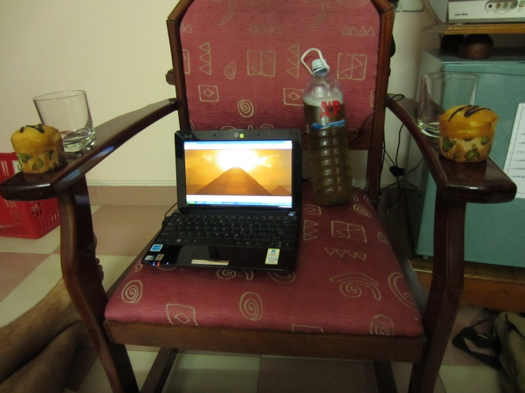 What we have here is mine and Jeff's dinner and entertainment, Hoi An style. The Mummy on laptop, a muffin each, and a bottle of take-away beer. Bon appetit!