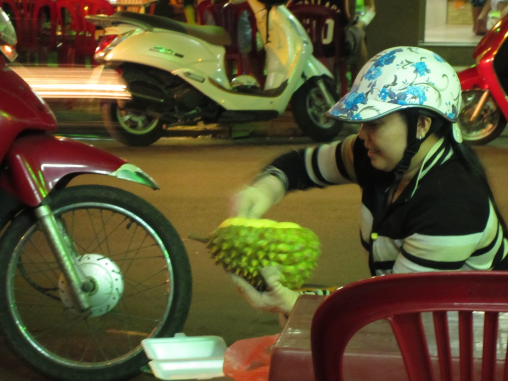 serving a durian at a vietnamese market