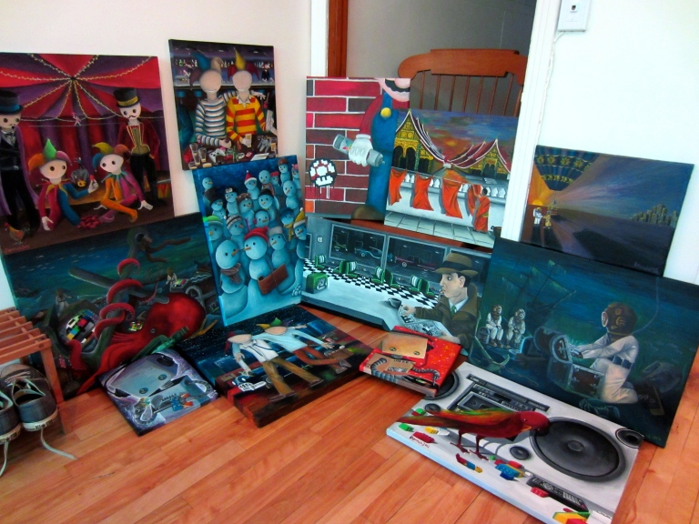 a pile of brightly coloured paintings on display