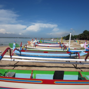 Brightly painted fishing boats in sanur bali