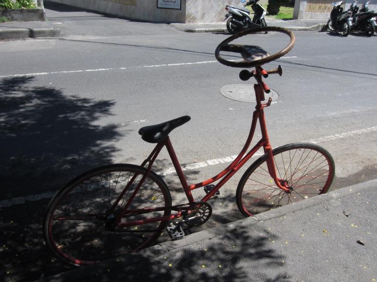 A bike with a steering wheel. Hello, crazy Asia!