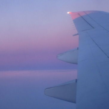 a beautiful purple sunset viewed through a plane window