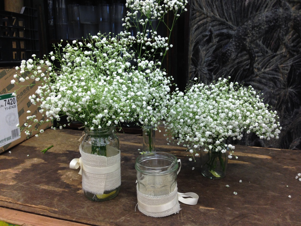 Wedding baby's breath flowers in mason jars