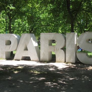 Giant letters in a park that spell paris