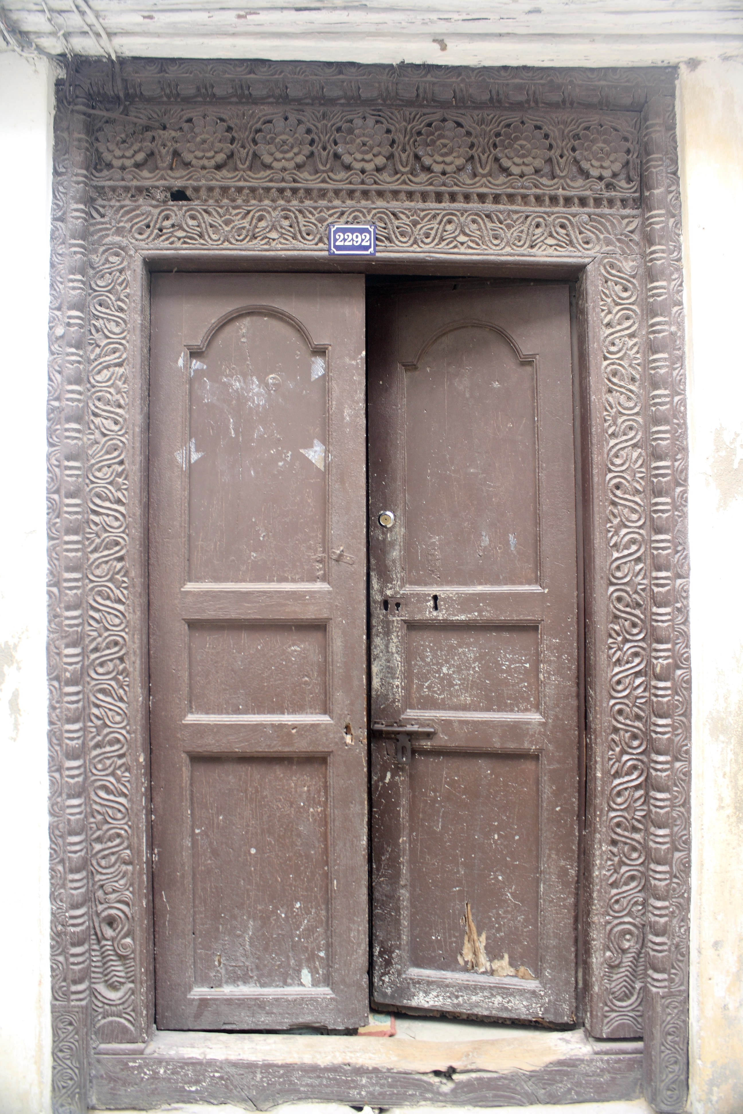 A wooden zanzibar door with one half open