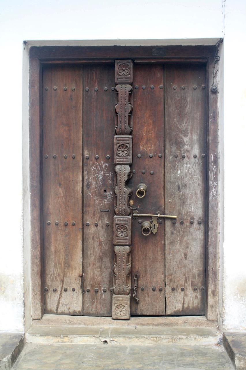 A faded wooden door in Zanzibar