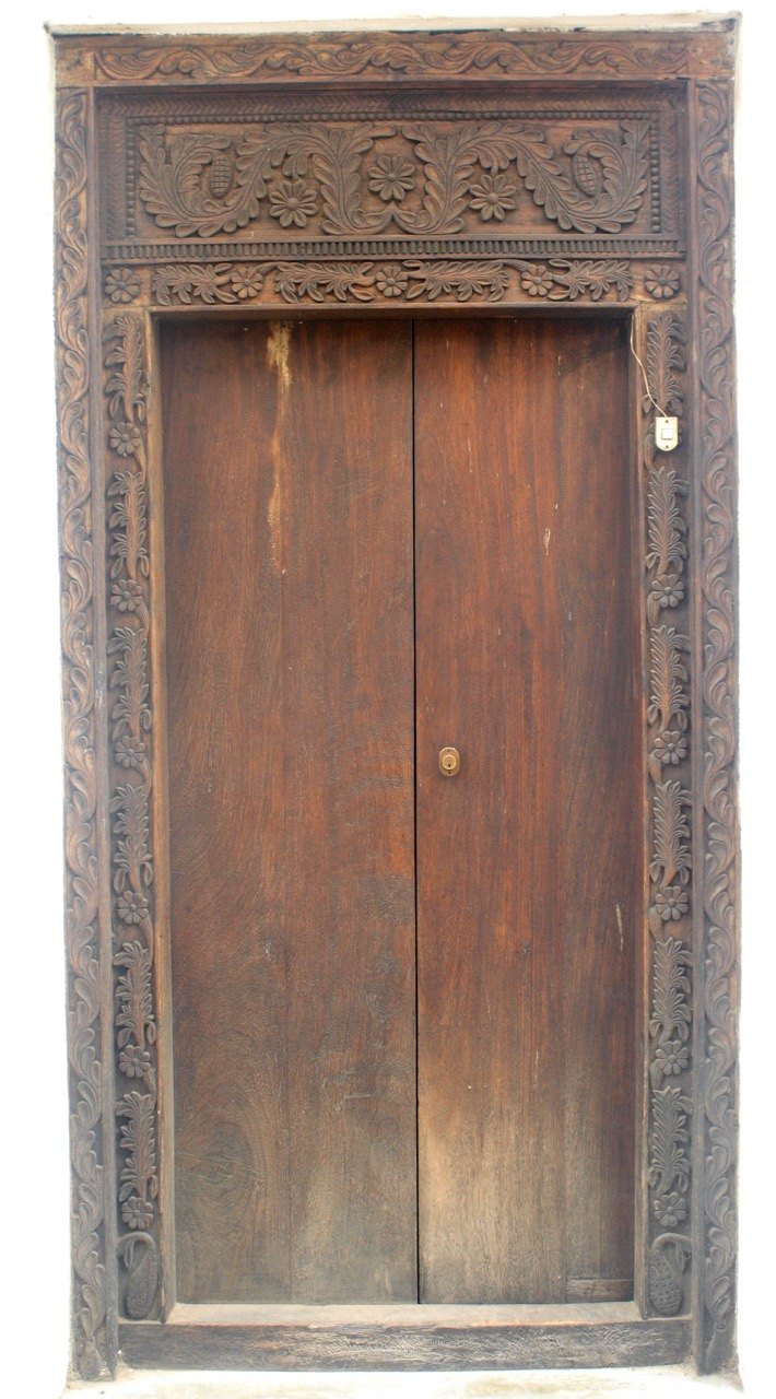 A wooden door in Zanzibar with lotus and leaf carvings