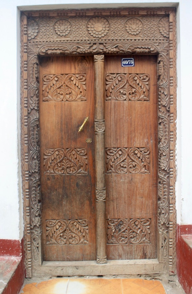 A Zanzibar door with lotus and leaf carved lintel