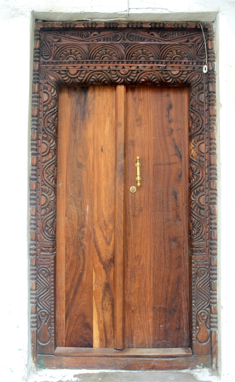 Zanzibar door with polished wood and carved frame
