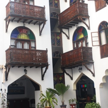 stained glass windows and a swimming pool at a zanzibar hotel