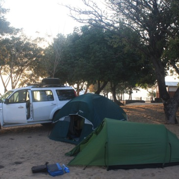 a white ford everest behind a campsite