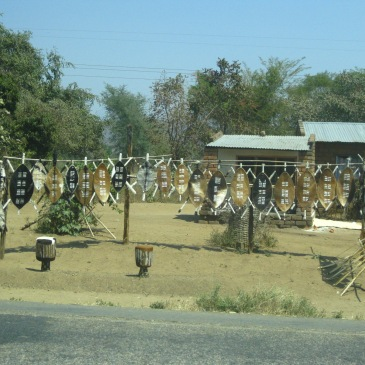a display of african shields on the side of the road