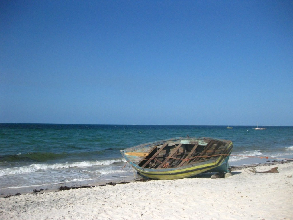Inhassoro beach with a small wooden boat